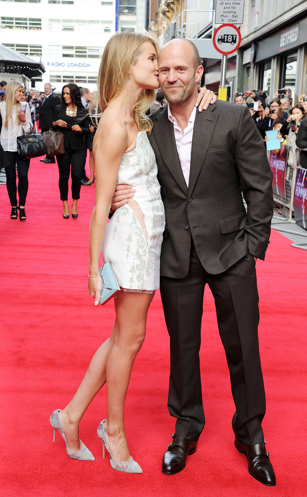 Rosie Huntington-Whiteley planted a sweet kiss on her boyfriend, Jason Statham, at his Hummingbird premiere in London.