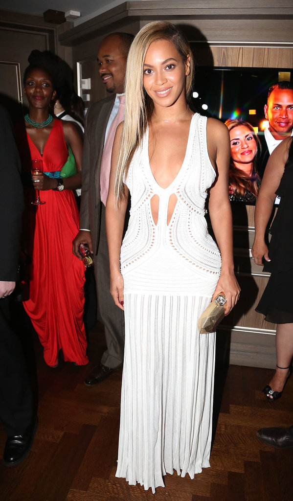 Beyoncé showed off her curves in a formfitting white maxi dress featuring a deep-V neckline and mini cutouts at the 10-year anniversary for Jay-Z's 40/40 Club in NYC.