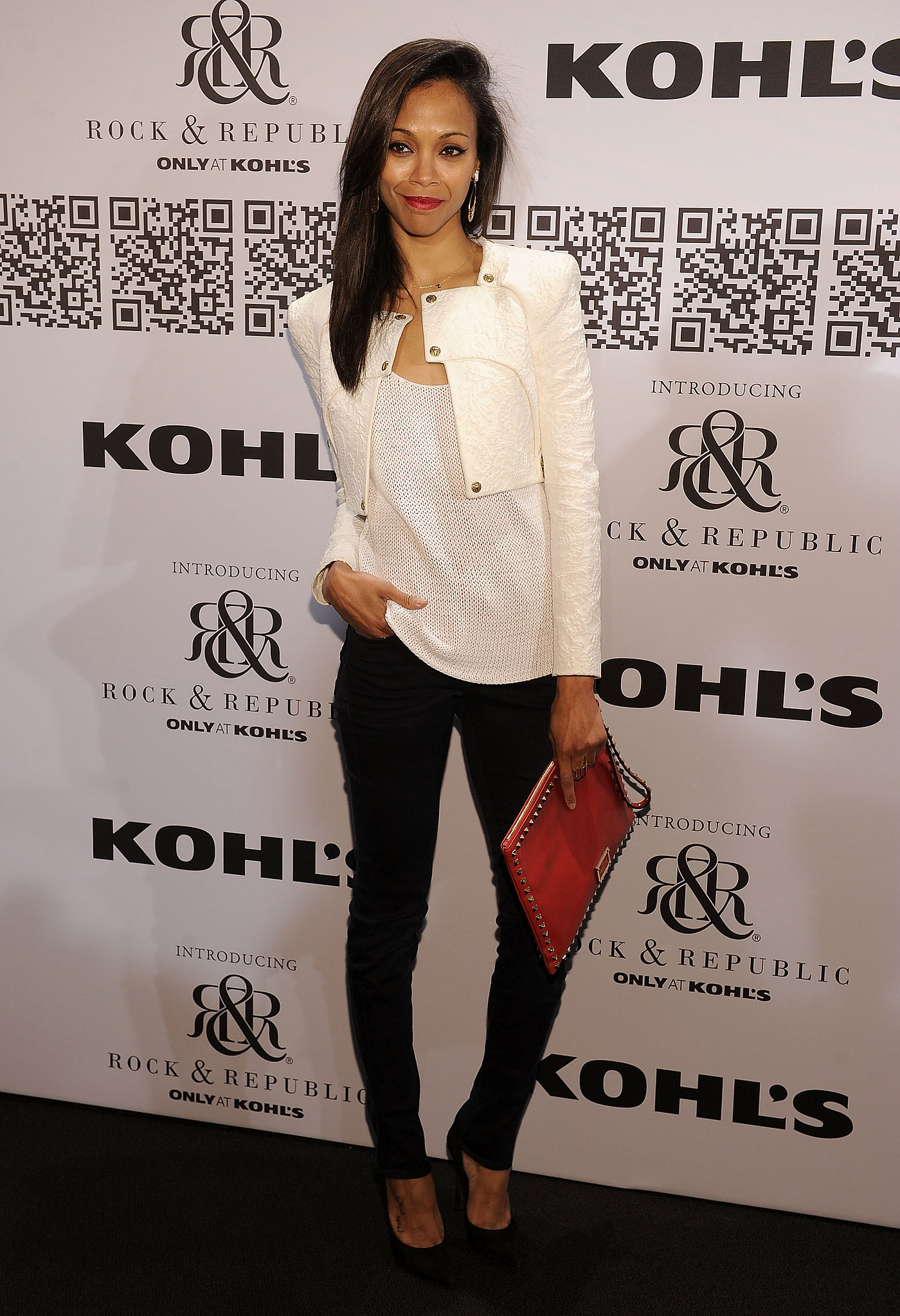 She accented her slick black and white ensemble with a fiery-red envelope clutch at Rock & Republic For Kohl's fashion show in February 2012.