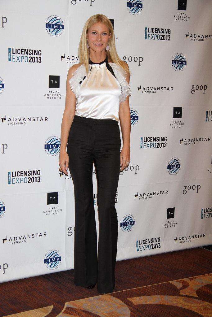 Gwyneth Paltrow tucked a silky white ruffle blouse into black wide-leg trousers, creating a menswear-chic pairing at an event in Las Vegas.