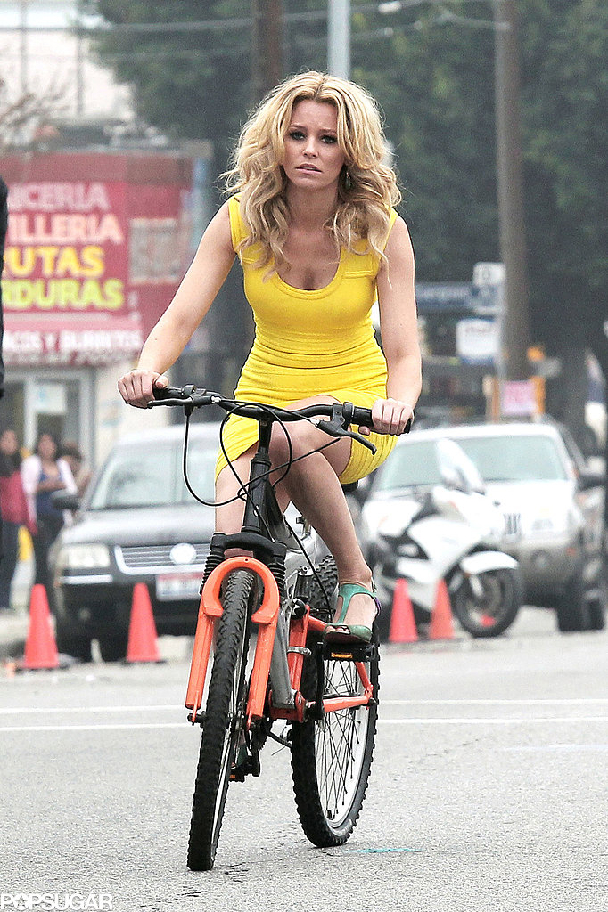 In February, Elizabeth Banks wore heels and a short dress while filming a cycling scene for Walk of Shame in LA.