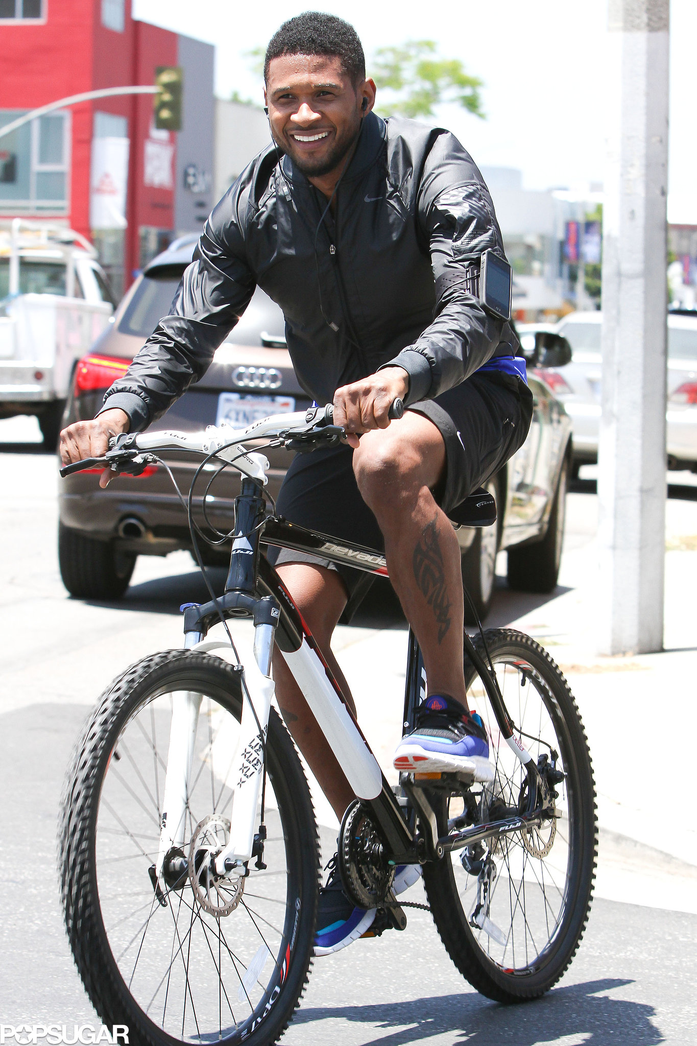 Usher was all smiles during a May LA bike ride.