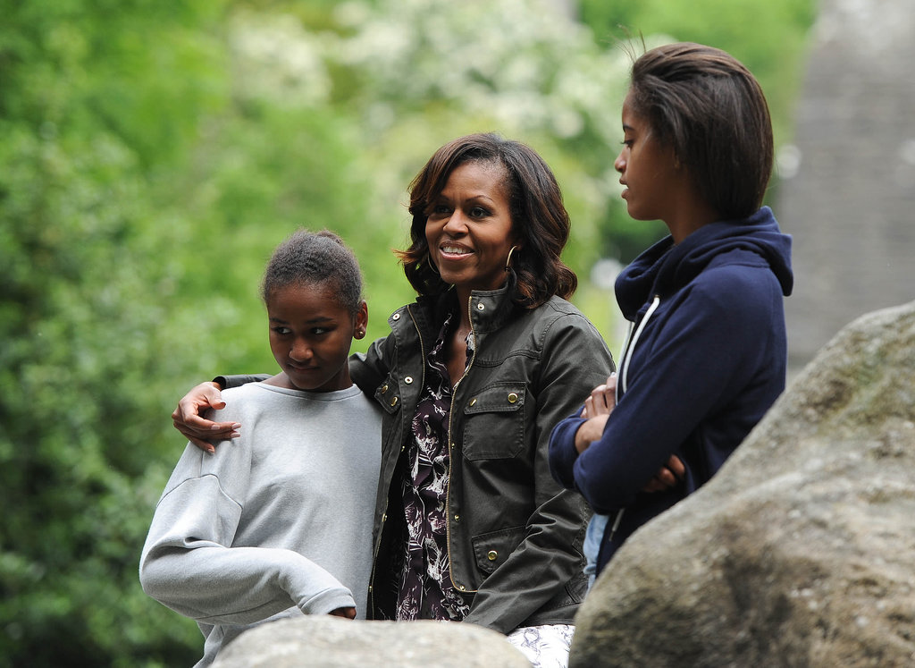 For a more casual approach in Glendalough, Ireland, the first lady looked cool as ever in a utilitarian jacket, a printed top, and oversize hoop earrings.