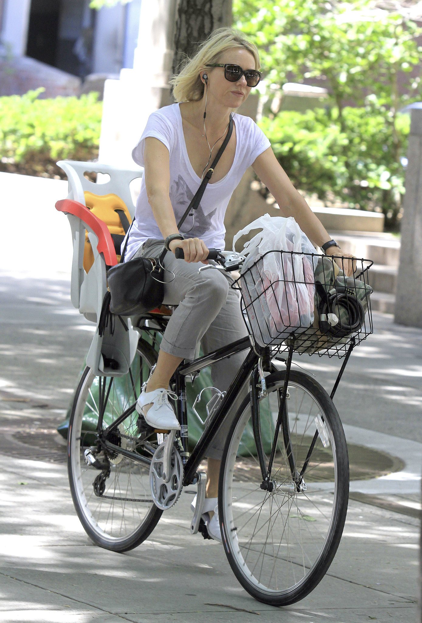 Naomi Watts hit up NYC on a bicycle in June.