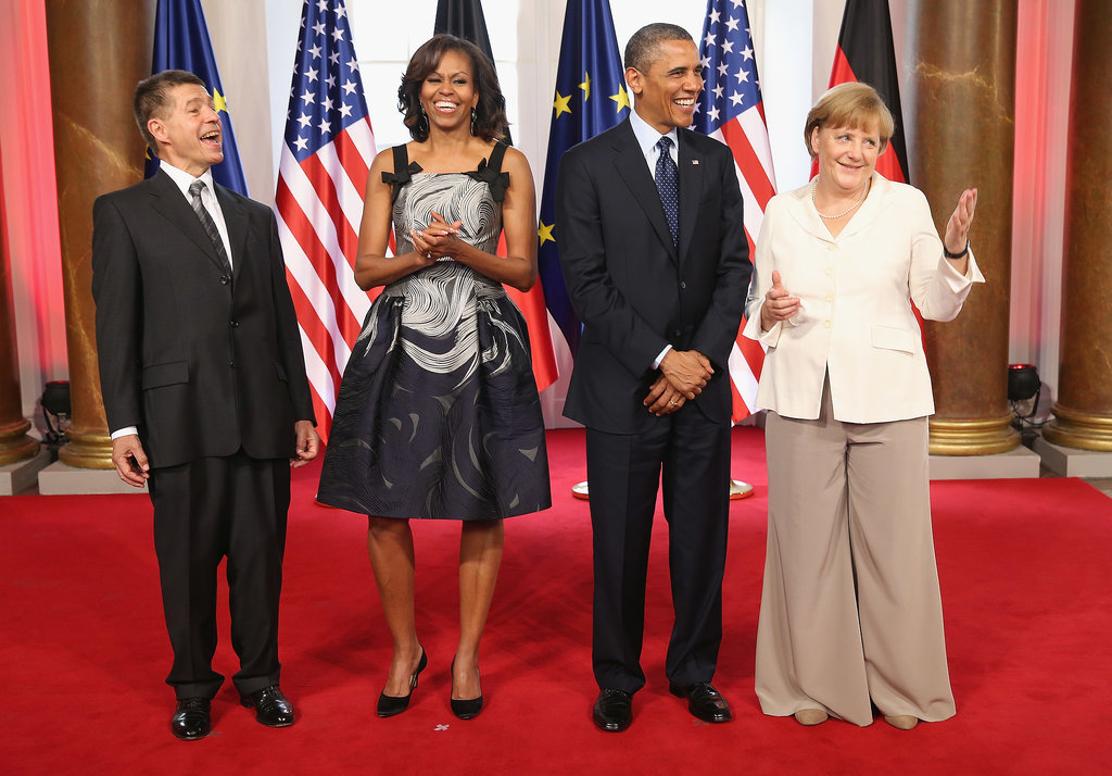 For her latest European appearance, a dinner at the Charlottenburg Palace in Berlin, Michelle Obama looked undeniably fabulous in a printed fit-and-flare Carolina Herrera dress — we especially adore the bow detail.