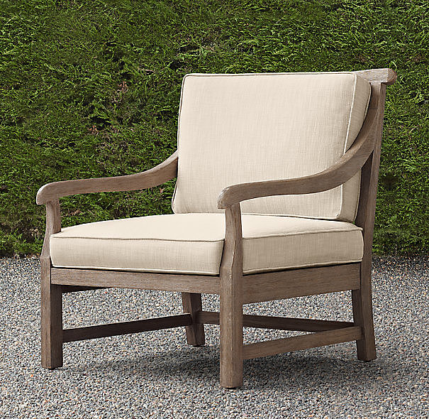 For a sophisticated look, opt for furniture that isn't trendy, like this teak lounge chair ($865, originally $1,150).