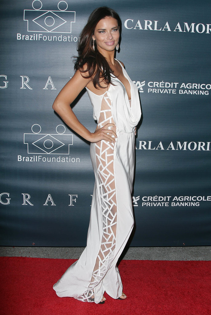 Adriana Lima put her sexy side on display in a white sheer (and plunging) gown at an event in Miami.