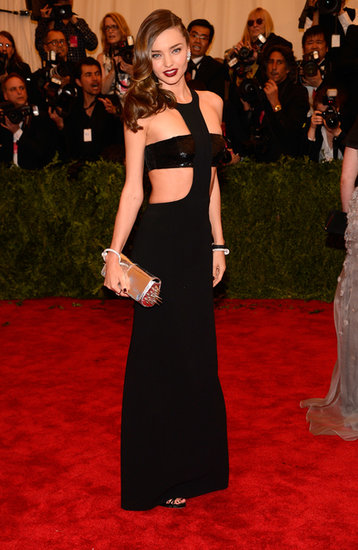 Miranda Kerr had one of her sexiest red carpet moments at the 2013 Met Gala. In sticking with the Punk: Chaos to Couture theme, she chose a black cutout Michael Kors gown with a spiked Christian Louboutin clutch.