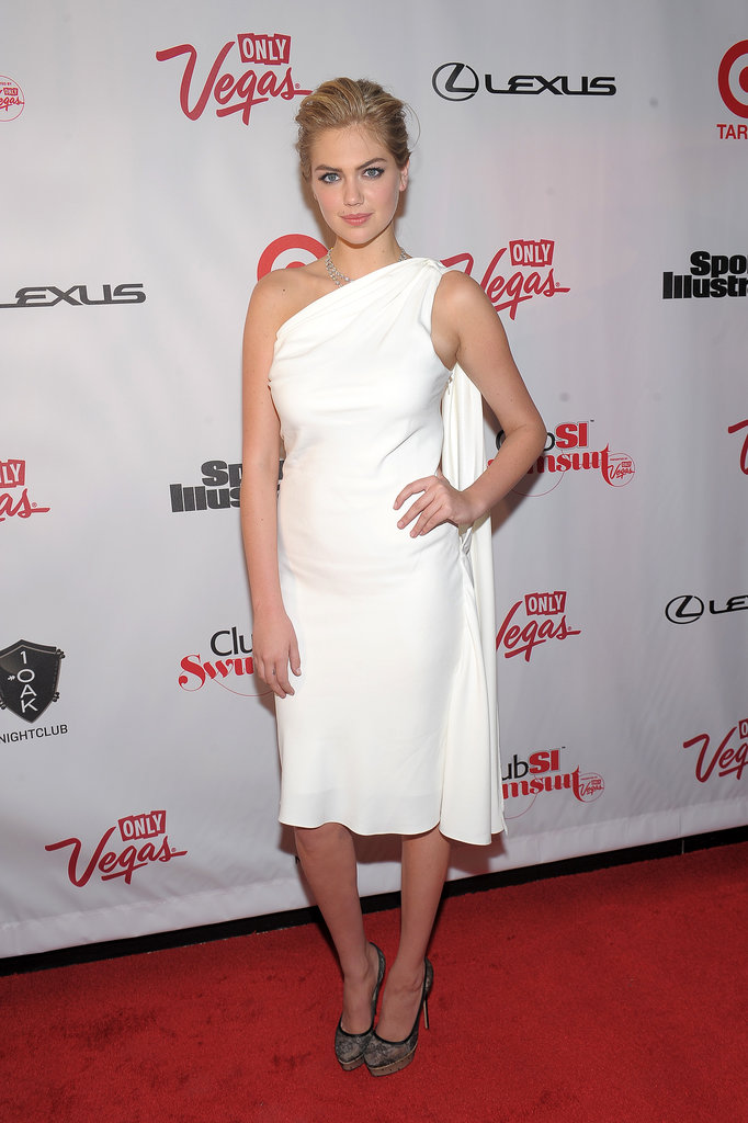 Kate Upton traded her bikini for a white one-shoulder dress at a Las Vegas affair.