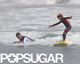 Proud dad David Beckham watched on as his son Romeo caught a wave in Malibu in July 2011.