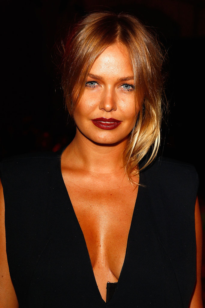Bronzed and beautiful, Lara wore vampy lips to Romance Was Born's Spring/Summer '13 show.