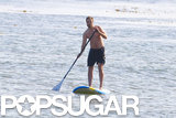 Robert Pattinson went shirtless on a paddleboard in Malibu in April 2012.