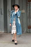 This showgoer charmed in a vintage-feeling crochet dress and denim overcoat.
