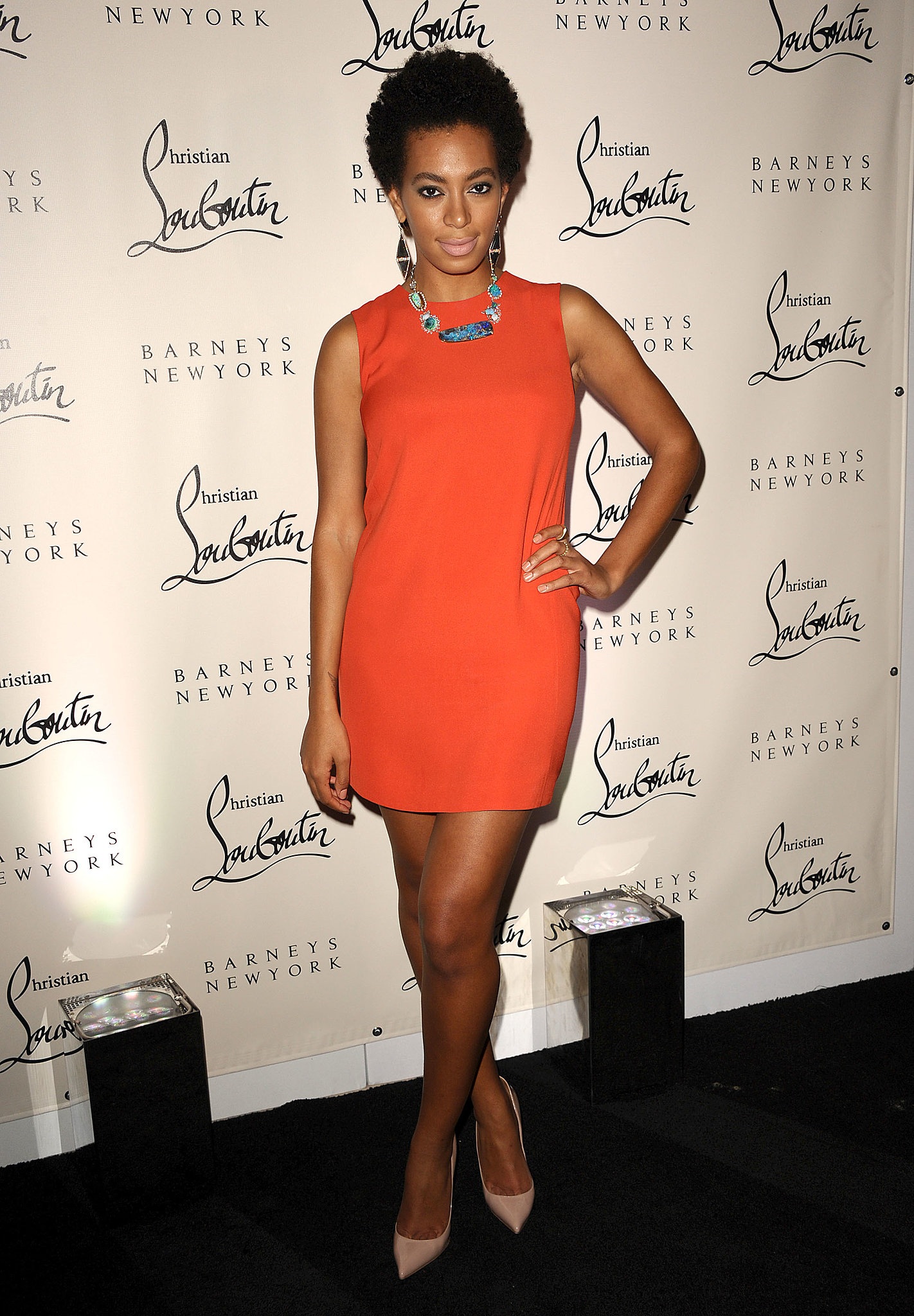 Solange donned a bright orange minidress with a beaded statement necklace and leg-lengthening nude heels for a Barney's New York event in 2011.