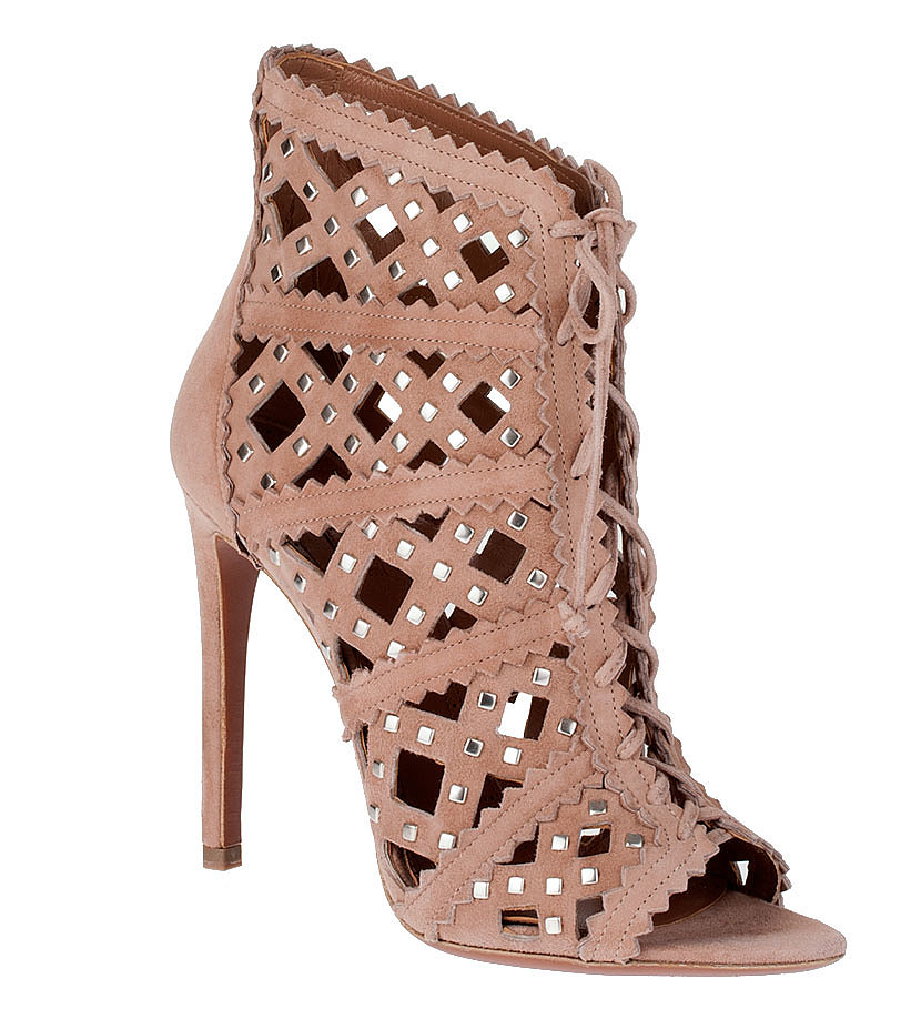 Make your trusty nude bootie Summer ready. Alaïa's cutout, studded pair ($1,885) is positively sizzling while also a match for every dress you own.