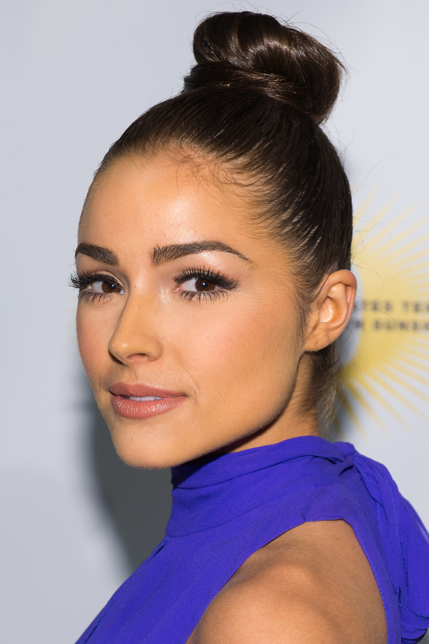 Olivia Culpo added oomph to the average sock bun by incorporating a wraparound piece at the base.