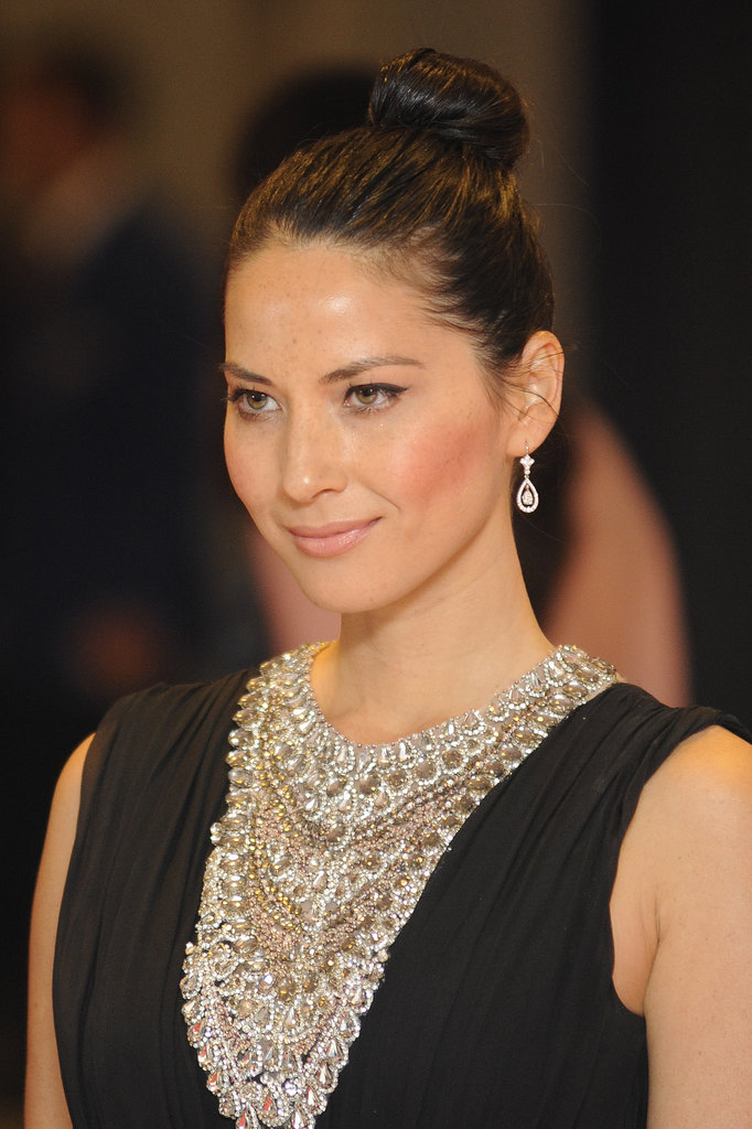 If you're looking to get a more formal style, take your cues from Olivia Munn. The actress slicked back her hair into an easy topknot that's also perfect for poolside lounging.