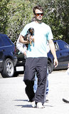 Josh Duhamel cradled his dog, Zoey, in his arms for an outing in LA in February 2009.