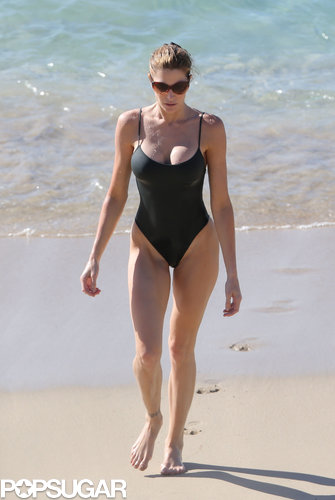 Working a classic black one-piece, Stephanie Seymour is the epitome of beach chic.