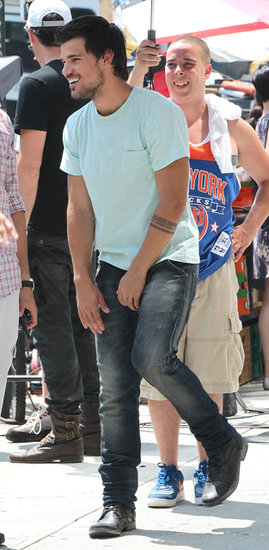 Taylor Lautner was smiling through some intense stunt work in NYC on the set of his new film Tracers on Monday.