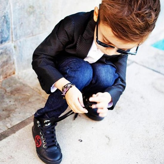 He may still be learning to tie his own shoes, but boy, does he look cool doing so. Source: Instagram user luisafereandmateo