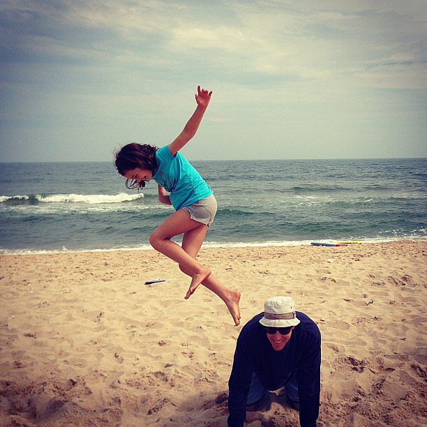 Ed Burns and his daughter, Grace, played on the beach.  Source: Instagram user cturlington