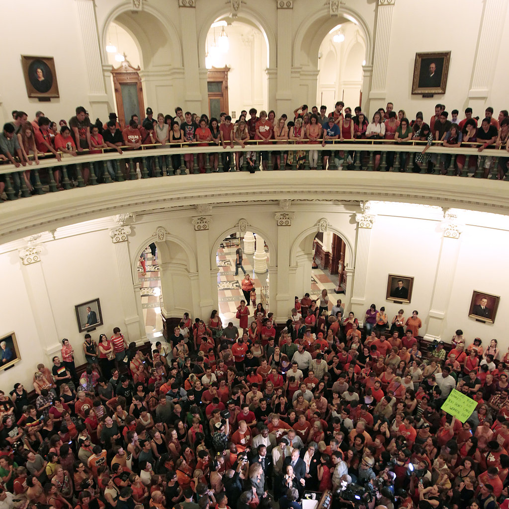 People gathered, cheered, and chanted at the capitol building in Austin, TX, to celebrate the defeat of SB5, an antiabortion bill that was defeated after Senator Wendy Davis's 10-hour filibuster.