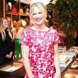 Ali Larter's piecey updo and red lipstick were feminine and flirty accents to her floral-print dress.