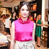 Crystal Reed matched her lipstick with her bright pink top and pulled her hair into a beautiful, piecey bun.