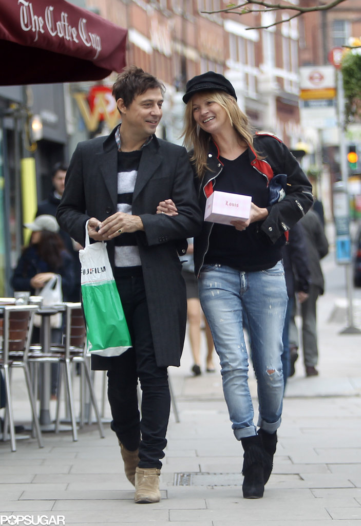 Jamie Hince and Kate Moss laughed together after stopping at a candy store in London in May 2013.