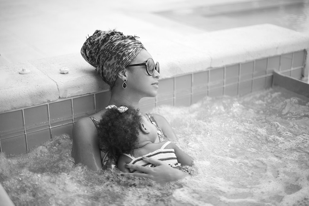 Beyoncé cuddled her daughter in the water.  Source: Beyoncé on Tumblr