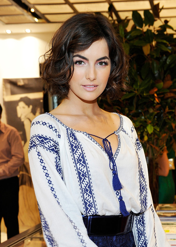 Also at the Carolina Herrera store opening, Camilla Belle stunned with her new haircut styled in effortless waves. She groomed her bold brows and paired them with a soft, feminine makeup look.