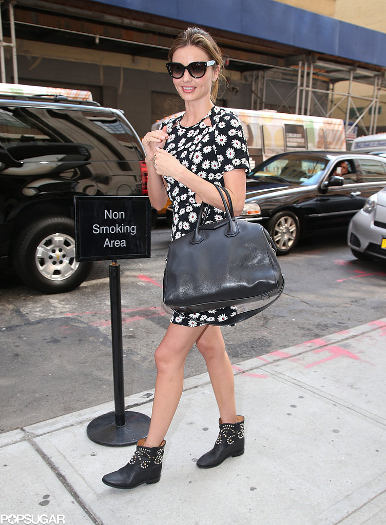 Miranda Kerr carried a black handbag and wore black boots.