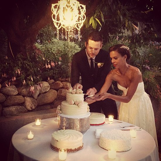 During their June wedding, Damien Fahey and Grasie Mercedes cut the cake underneath a chandelier.  Source: Instagram user bradleymeinz