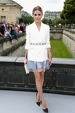 Also at the Dior Couture show in Paris, Olivia Palermo donned Dior: a white jacket, pink-and-blue organza skirt, black pumps, an embellished belt, white clutch, and matching cuffs.