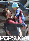 Andrew Garfield had fun with a baby between takes on the Amazing Spider-Man 2 set in NYC.