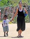 Sandra Bullock held on to her son Louis's hand.