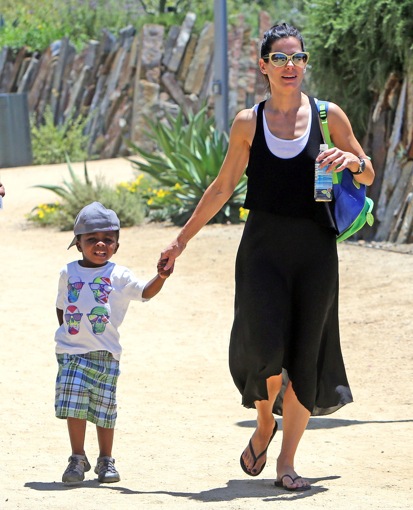 Sandra Bullock and Louis Bullock held hands.