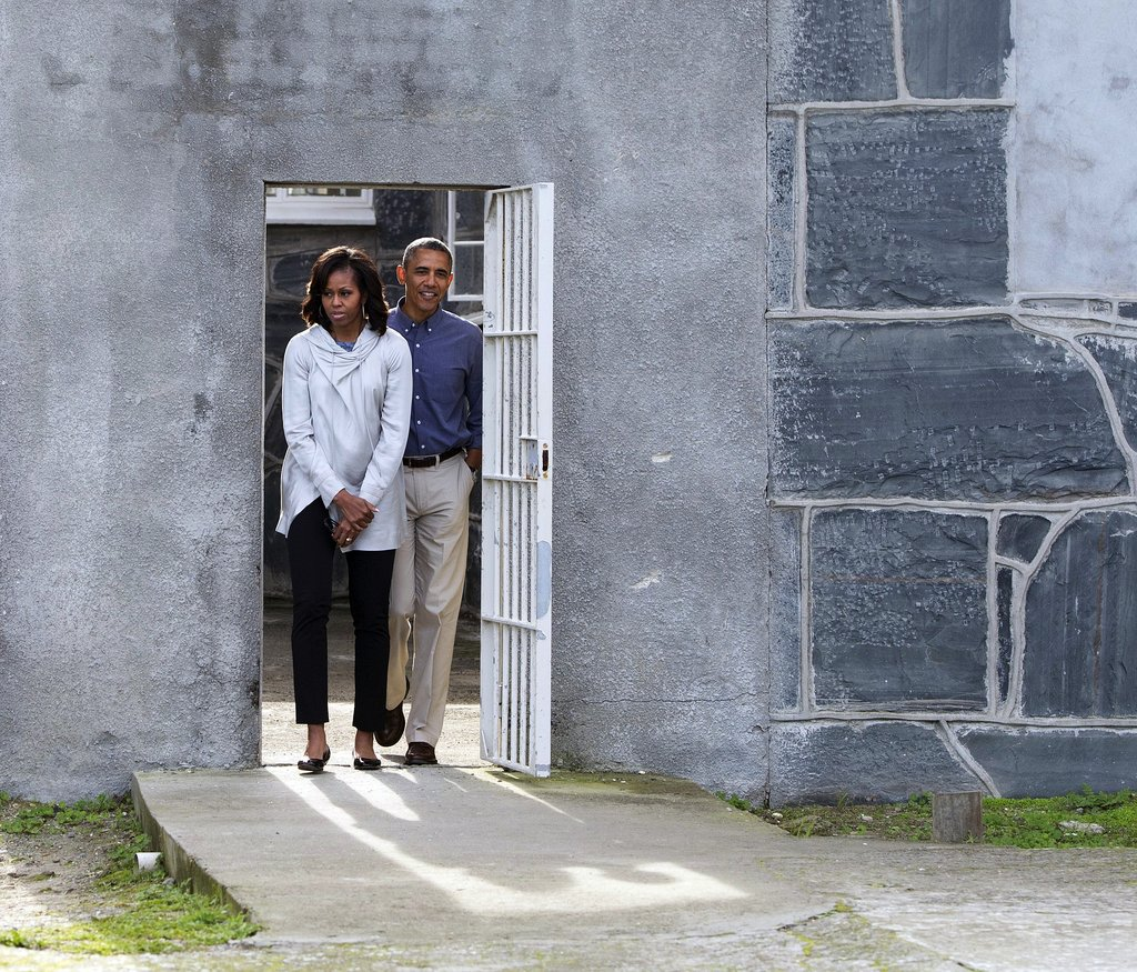 For her visit to Robben Island in South Africa, Michelle kept her look much more subdued in black cropped trousers and a gray cowl-neck jacket.