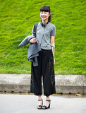 Cropped wide trousers provided plenty of volume; tamper it with a slim tee like this stylish Parisienne.