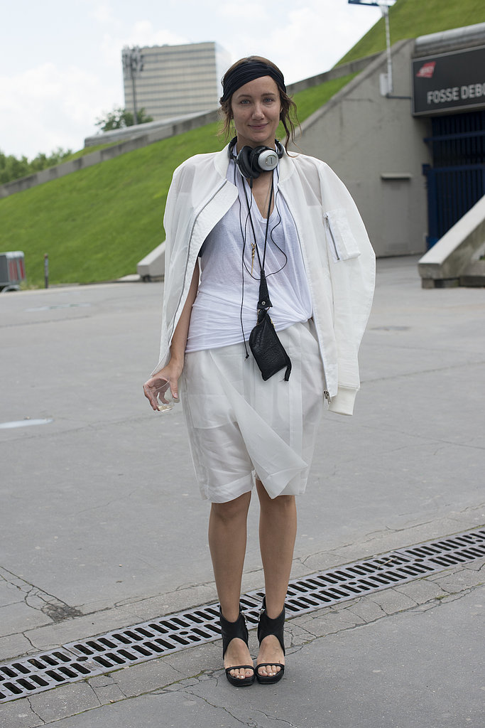 An all-white ensemble was set off by black sandals and a necklace.