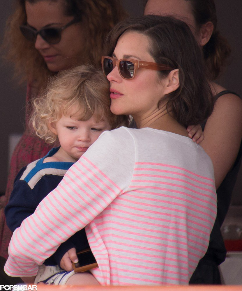 Marion Cotillard held her son, Marcel, close at the Monaco Jumping Show on Sunday.