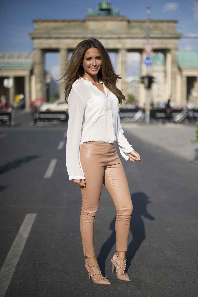 A minimalist's dream outfit: a silky white blouse with nude leather pants and Valentino's rockstud pumps.