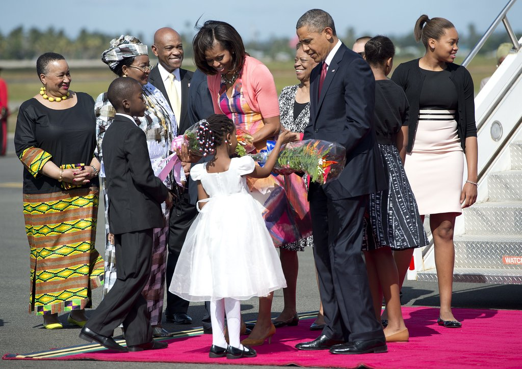Children greeted President Obama and First Lady Michelle with flowers when they arrived in Dar Es Salaam, Tanzania, in July.