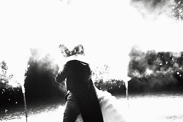 The newlyweds embraced amongst ground fireworks. Photo by Nick Tucker via Snippet and Ink