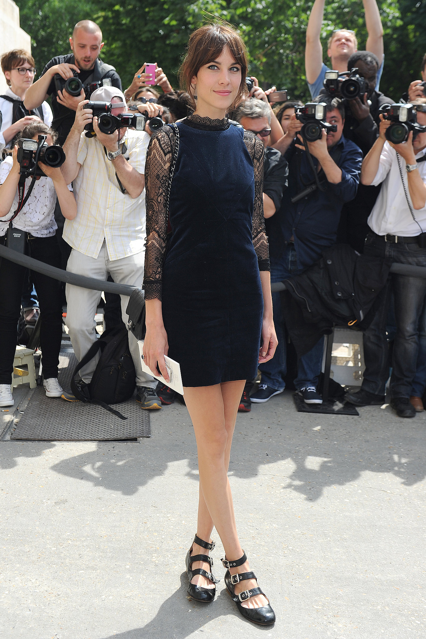 For the Chanel show, Alexa Chung chose a long-sleeved navy sheath and tribuckled flats.
