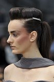 The hair at Chanel was a pompadour and ponytail combination that was accented with either a hat or a U-shaped barrette.