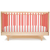 The contemporary yet classic Caravan Crib ($895) is sustainably constructed from solid maple and comes in red, yellow, green, and blue.