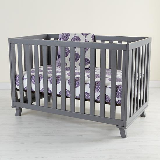 Elegant and understated, El Greco Woodworking's Low-Rise Crib ($900) for The Land of Nod converts to a toddler bed with an optional conversion kit, and makes it easy to reach in and put baby to rest.