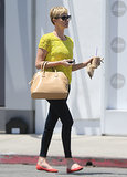 Charlize Theron added a pop of yellow to her casual ensemble via a lace tee by Madewell.